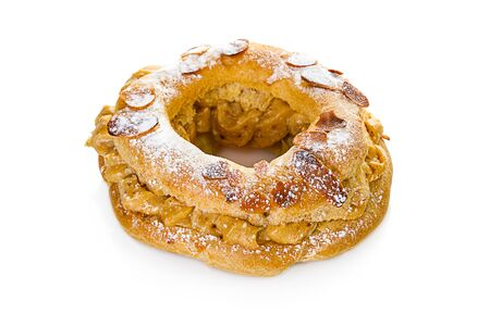 Tasty Paris Brest with almond stuffed with caramel cream isolated on white background