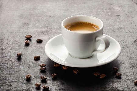 cup of coffee standing on old rustic background Standard-Bild