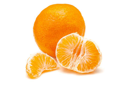Whole mandarie and segments isolated on white background
