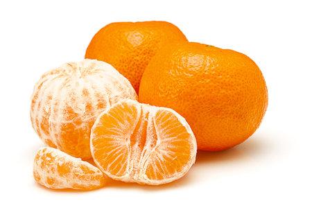 Whole mandarins and segments isolated on white background