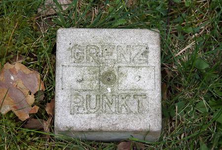 delimitation: Landmark of concrete with Scripture Stock Photo