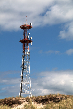 Radio tower behind a dune Stock Photo