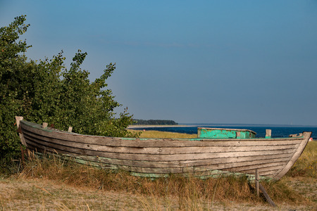 Old wooden boat, at a beach access
