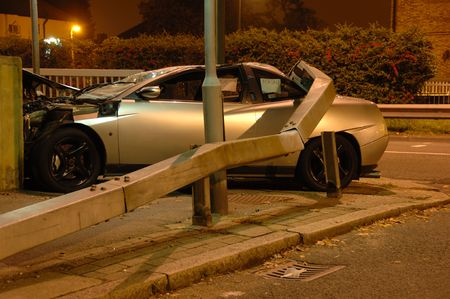 road barrier: Car crashed under barrier at night Stock Photo