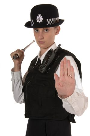stance: Uniformed UK female police officer in ready stance holding metal telescopic baton isolated on white