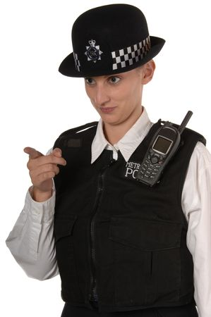 Uniformed UK female police officer in ready stance holding metal telescopic baton isolated on white