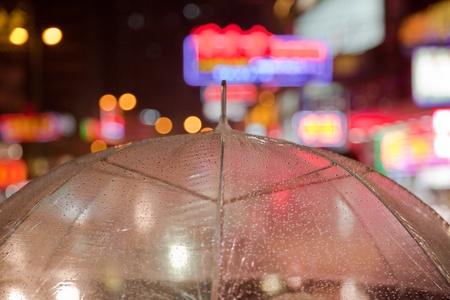 Transparent umbrella with city lights photo