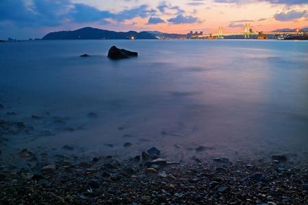 Sunset over Gwangan bridge in Busa, South Korea photo