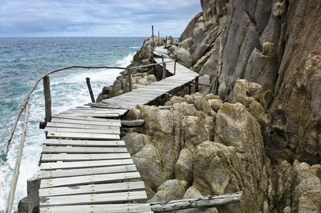 Old wooden pathway over the sea Stock Photo - 11194838