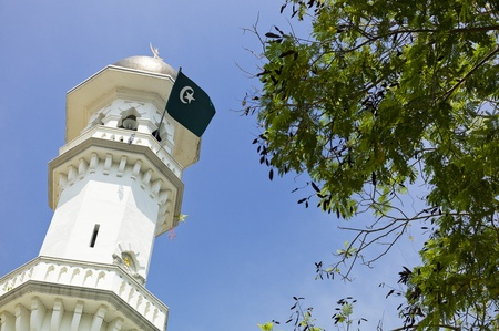 Minaret with islamic flag  photo