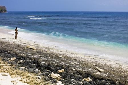 Beautiful woman in a tropical beach in Bali, Indonesia photo
