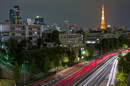 City nights scene with car motion lights and Tokyo Tower on the background, Japan photo