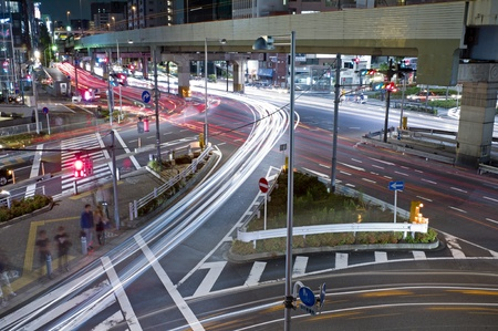 City night scene with car motion lights in Tokyo, Japan photo