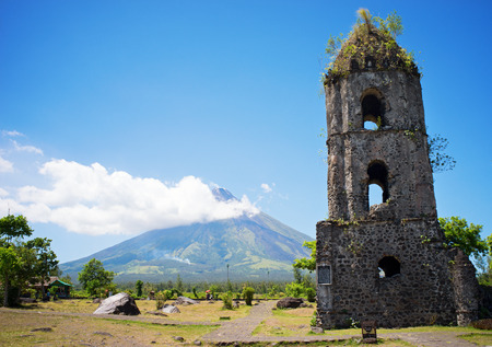 mount: Cagsawa church ruins with the smoky Mount Mayon volcano in the background, Albay, Philippines