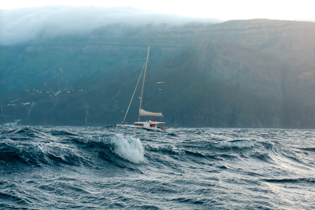 Yacht catamaran in the stormy ocean near the island of La Gomera.