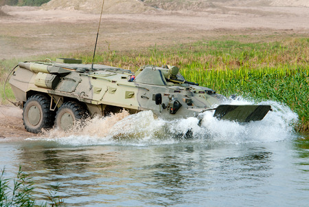 enters: APC BTR-80 enters the water, for crossing the river. Editorial