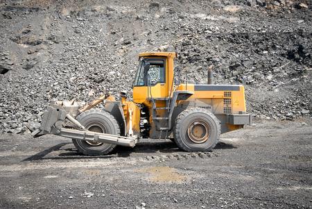 frontend: Wheel bulldozer working in career.