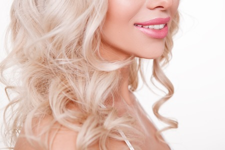 perfect smile: perfect smile with white teeth of youth curly blonde women