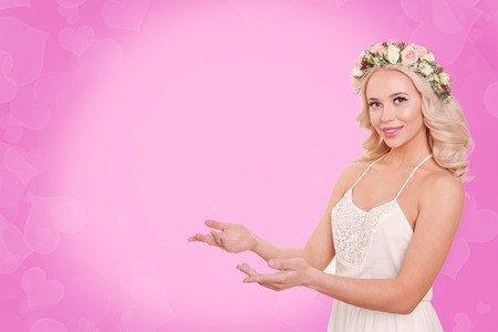 blondy: Beauty romantic woman with pink and white Rose flowers in her curly hairs. Valentine. Bokeh. Pink background. Concept love. Copyspace Stock Photo