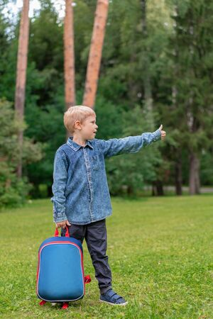 portrait of cute boy with backpack. School. First grader. Outdoor