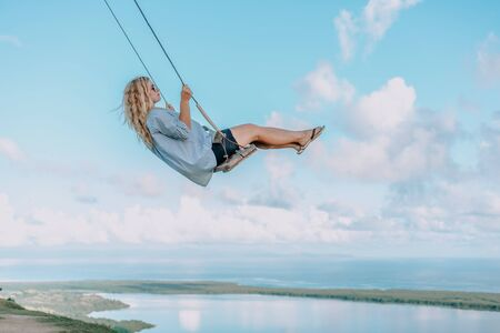 Beautiful view of young woman swing on the top of the mountain Redonda in Dominican Republic. Concept travel, vacation, tourism Foto de archivo - 133208833