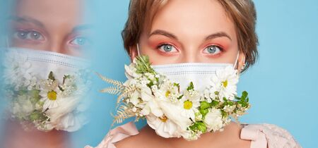 Face mask design with flowers. Portrait of beautiful woman with blue eyes, fashion make-up and mask over blue background