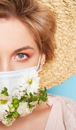 Face mask design with flowers. Portrait of beautiful woman with blue eyes, straw hat and mask. Summer