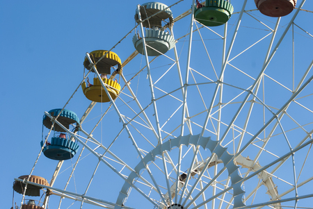 Ferris wheel on the blue sky background