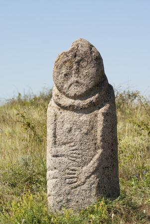 idol: Scythian stone idol Kurgan stelae Babah in the steppe. National steppe reserve Stone barrows, Donetsk region, Ukraine Stock Photo