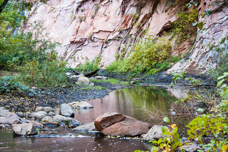 rock creek: Serene Creek running on Sedona Hiking  trail. With Red Rock canyon in background,