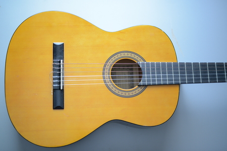 resonating: Fragment acoustic guitar closeup