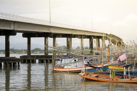 trawler net: Fishing Boat in sea at sunset.