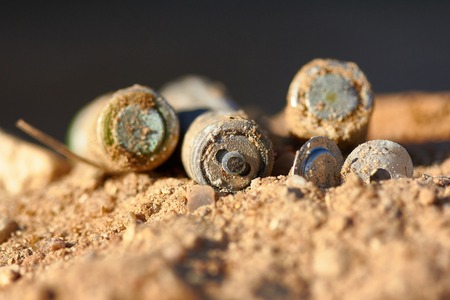 Exhaust alkaline batteries improperly thrown away, not recycled and are poisoning the land.