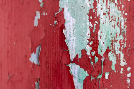 Old red cyan paint on wall.