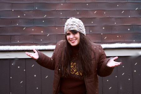 Happy Woman Playing in Snow
