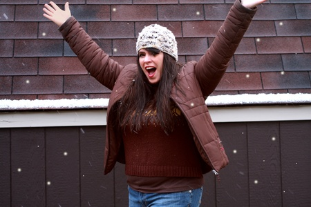 Pretty Woman Excited Playing in Snow