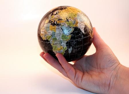 Globe in Hands Business World Economy Reklamní fotografie