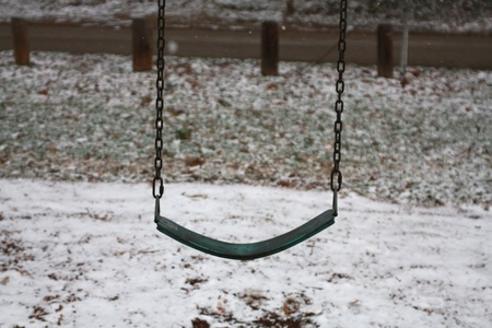 Outdoor Park Swing Isolated in the Snow