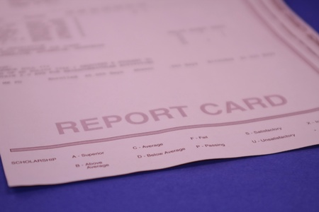 Report Card for Student on Blue Background