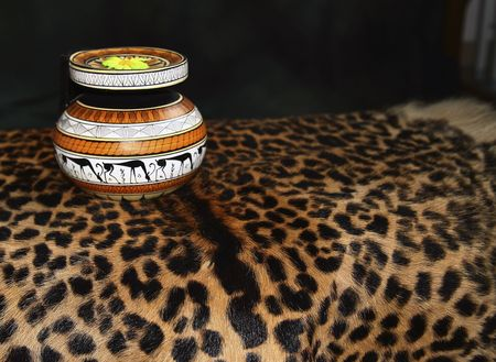 The African ceramic vase worth on a skin of the leopard photo