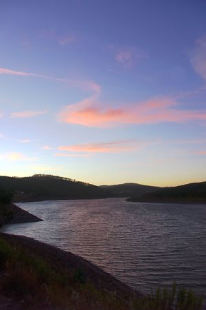 atmospheric phenomena: The sunset has given to the sky unusually beautiful colors. Portugal. Lake.