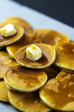 freshly prepared pancakes with maple syrup for breakfast Banco de Imagens