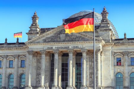 The German flag streaming in front of the German parliament buil Stok Fotoğraf