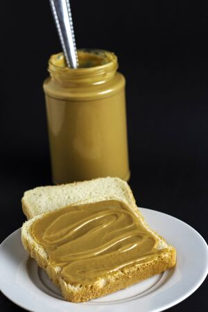 slice of fresh bread with peanut butter