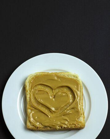 slice of fresh bread with peanut butter. Top view Zdjęcie Seryjne