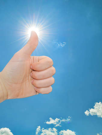 Thumbs up in the sun Stock Photo