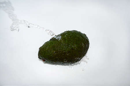 Avocado with a water jet