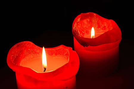 two burning red candles
