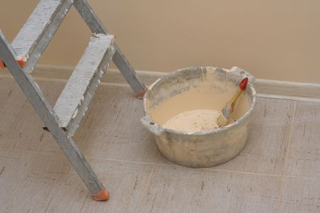Tools for appartment improvement � ladder and basin with brush on background of painted wall Stock Photo - 2656318