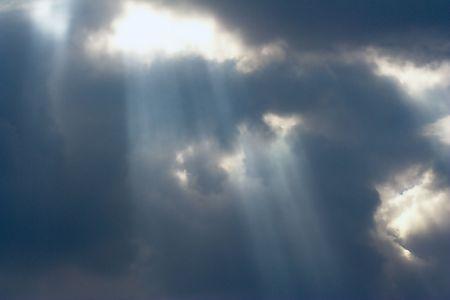 lightbeam:  Sun rays penetrating cloudy sky